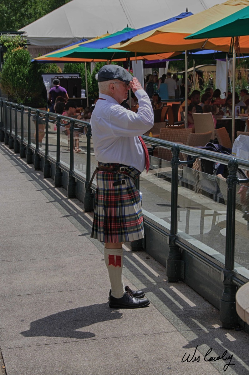 Scottish man in kilt saluting nik hdr color signed